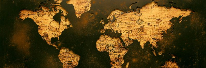 golden colour map with metal cut out to frame the continents.